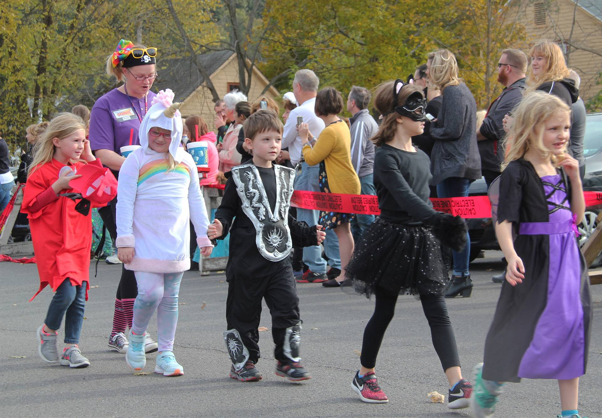 students walking dressed in halloween costumes