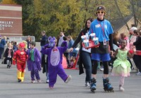 students and teachers walking in halloween parade