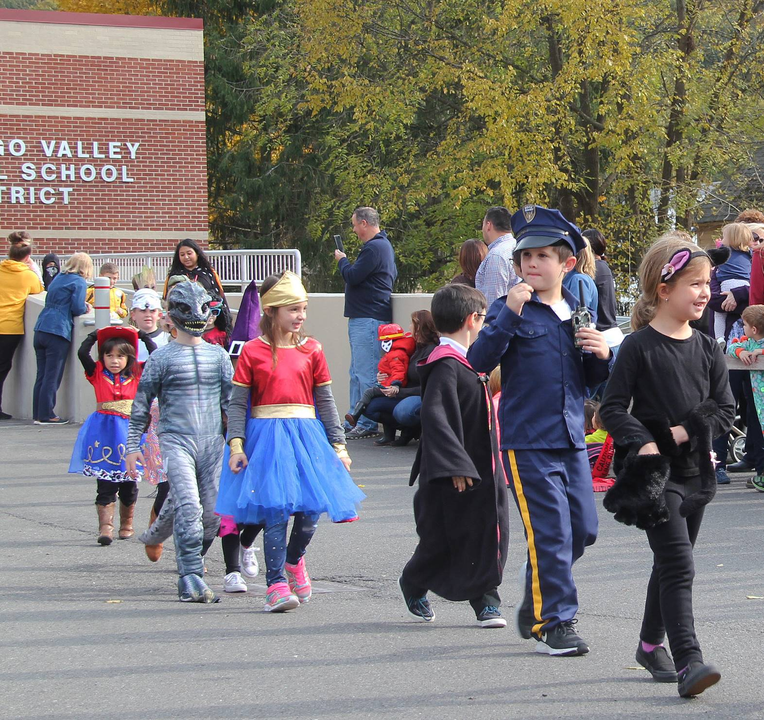group of students parading in halloween costumes