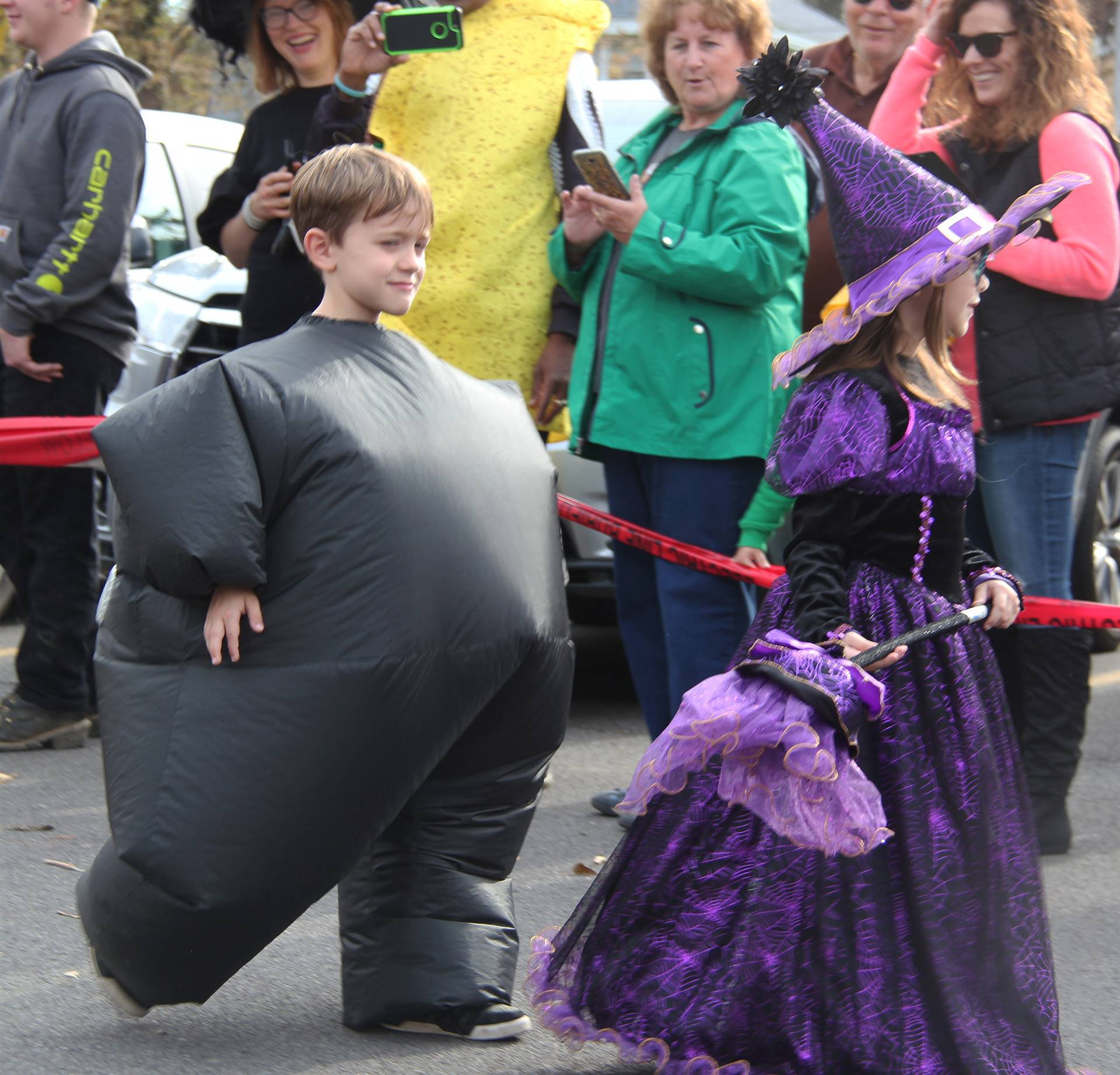 two students walking in halloween costumes