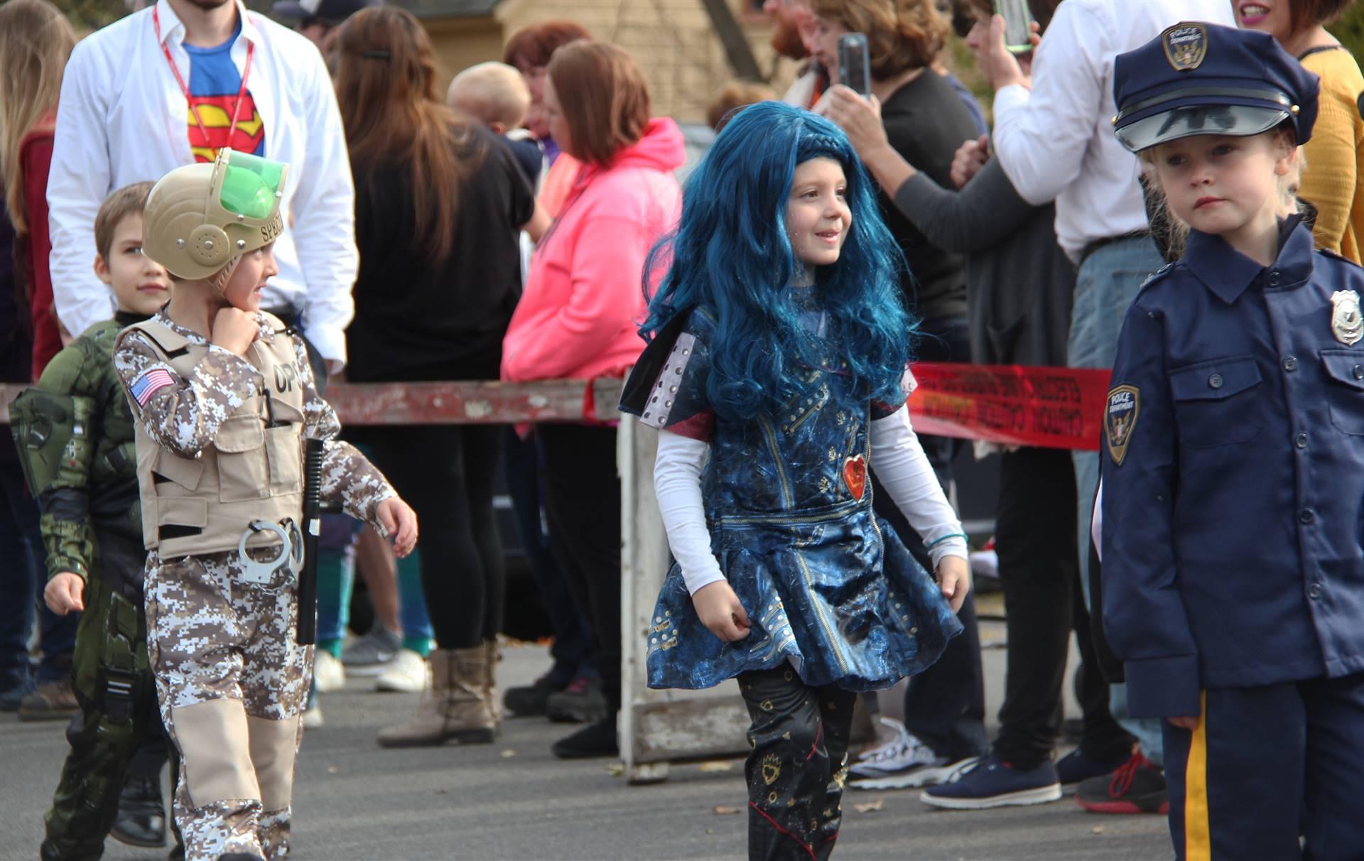 students walking wearing halloween costumes