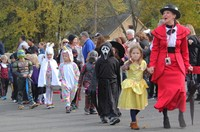 students and teacher parading in halloween costumes