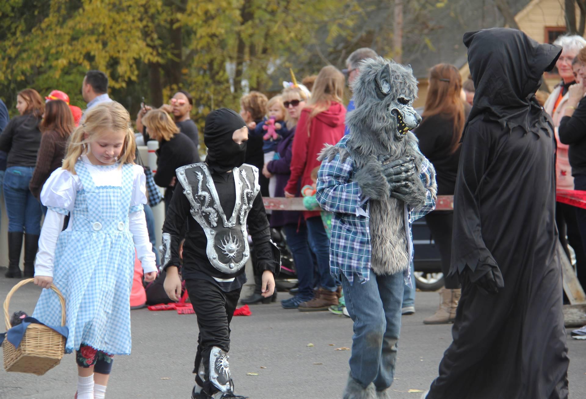students walking in halloween costumes