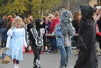 students walking in halloween costumes