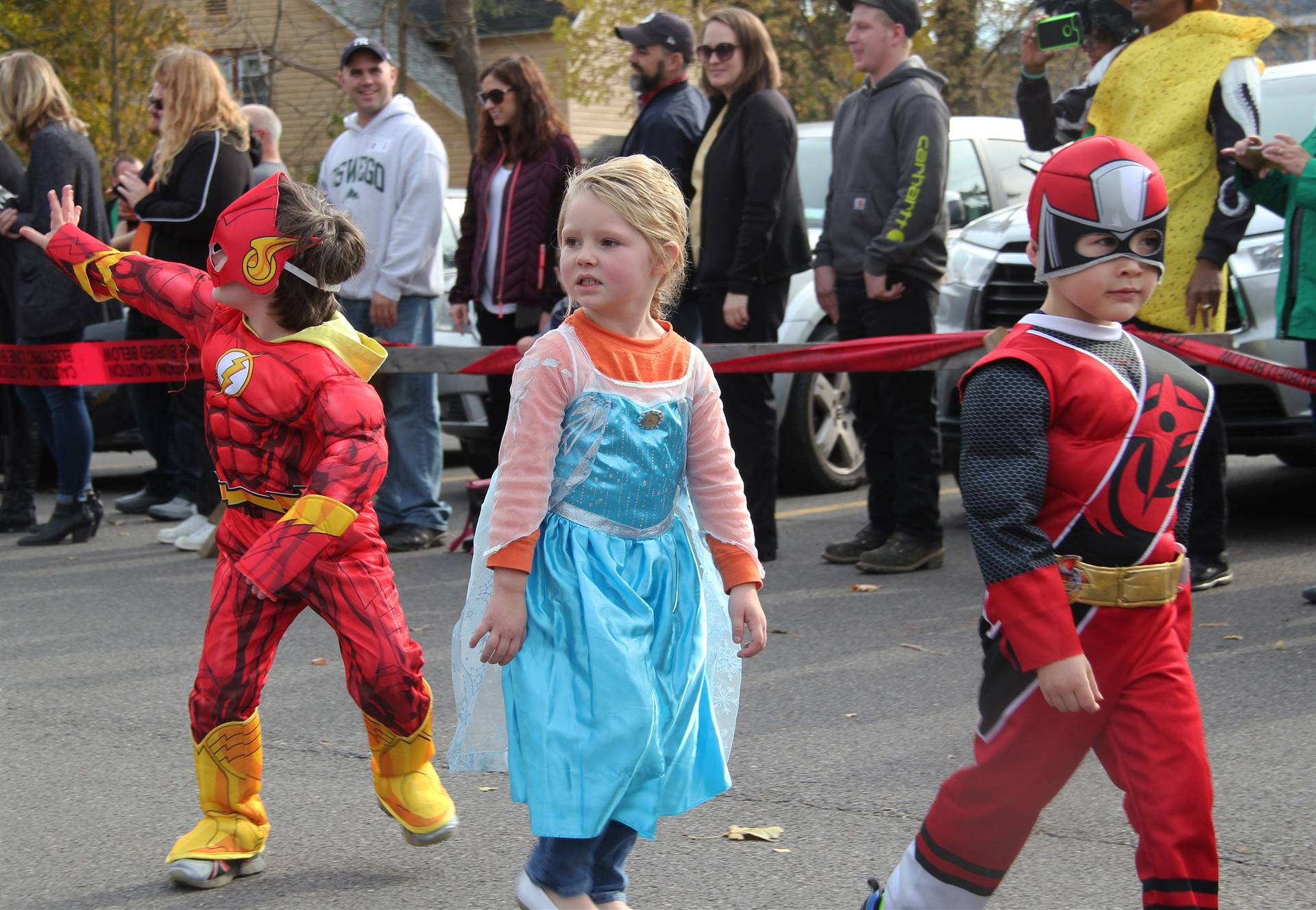 students parading in halloween costumes