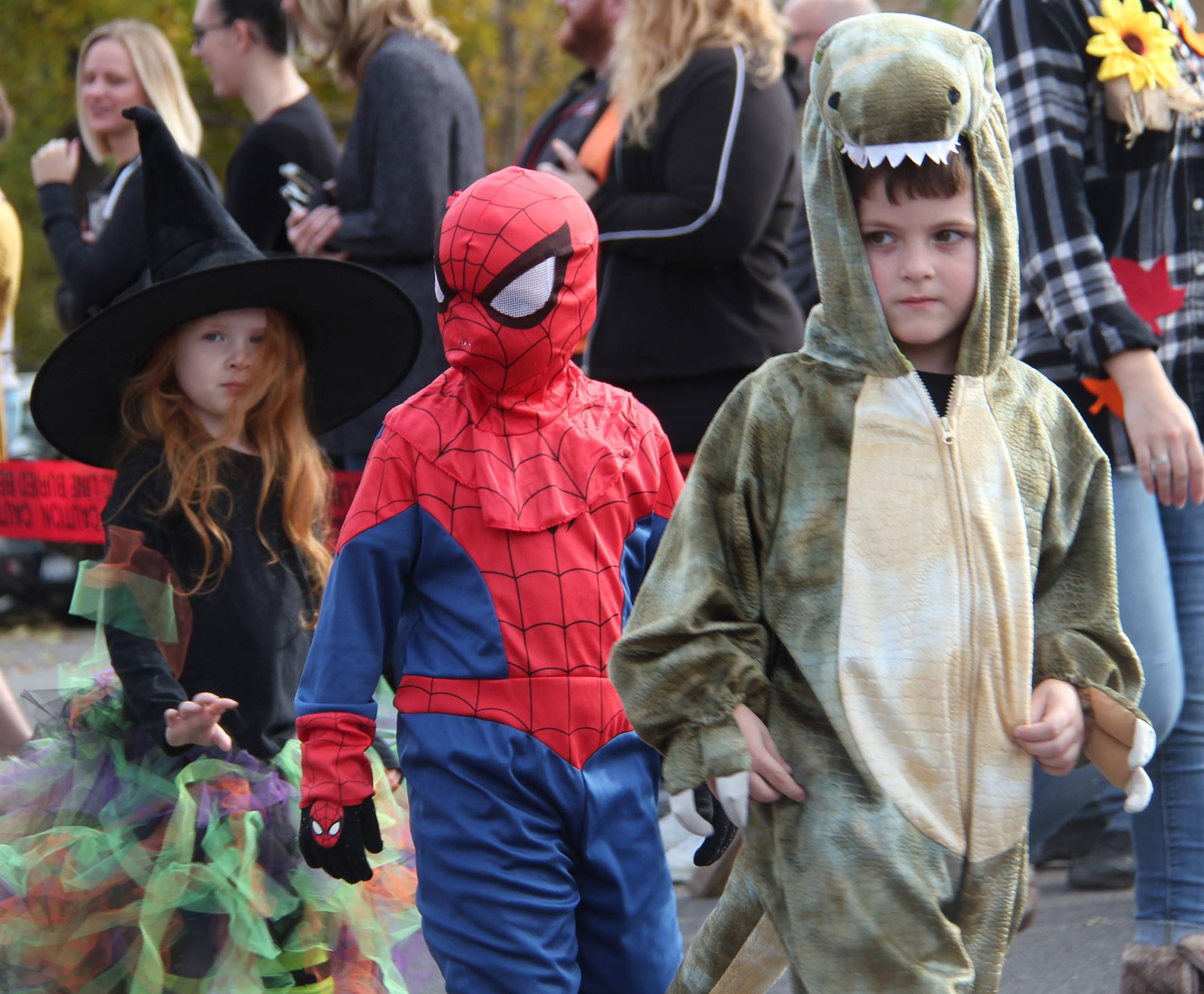 three students wearing costumes