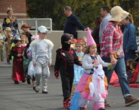 students and teacher parading in halloween costume