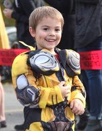 student smiling wearing costume