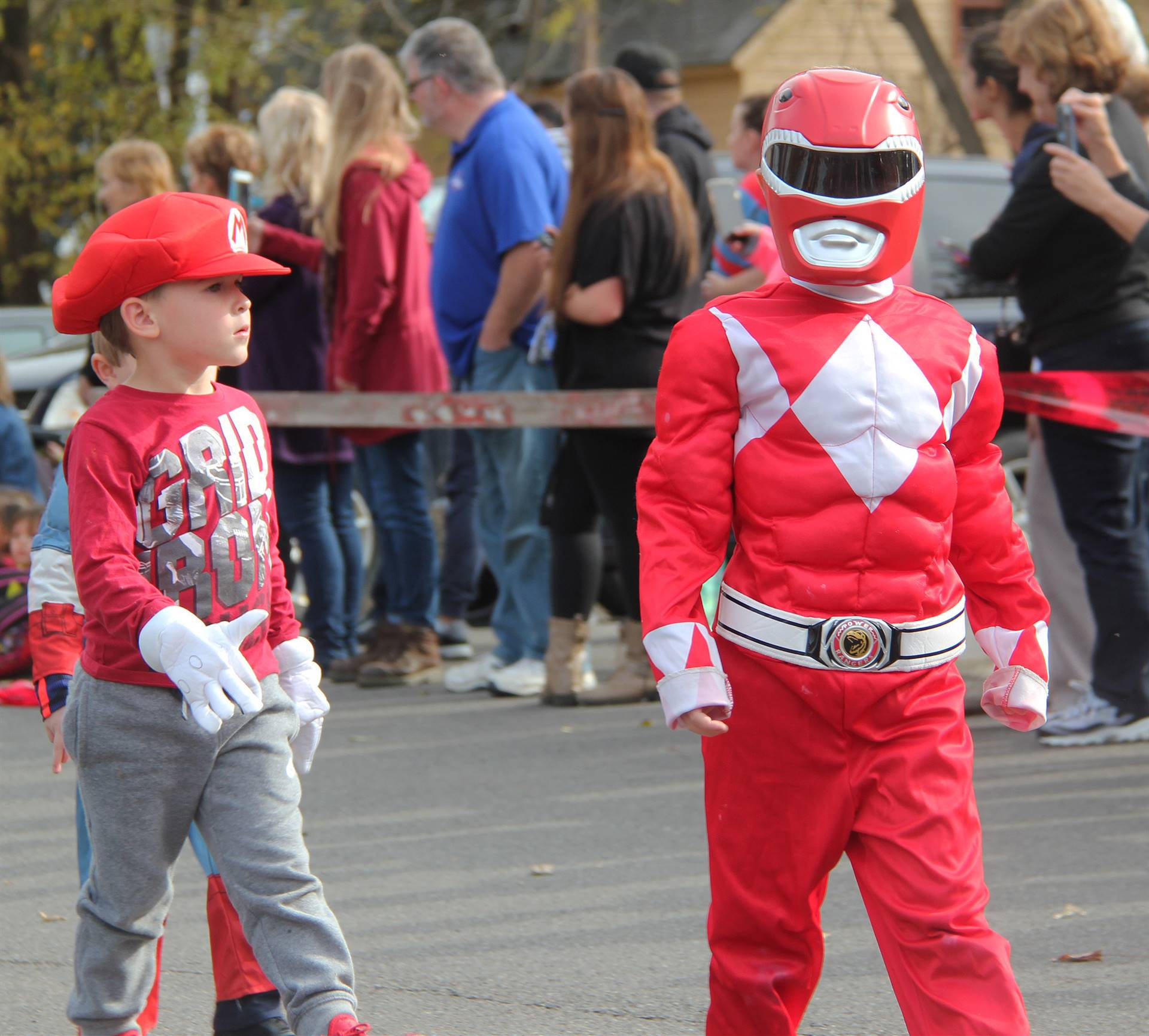 students parading wearing halloween costumes