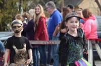 two students walking wearing halloween costumes