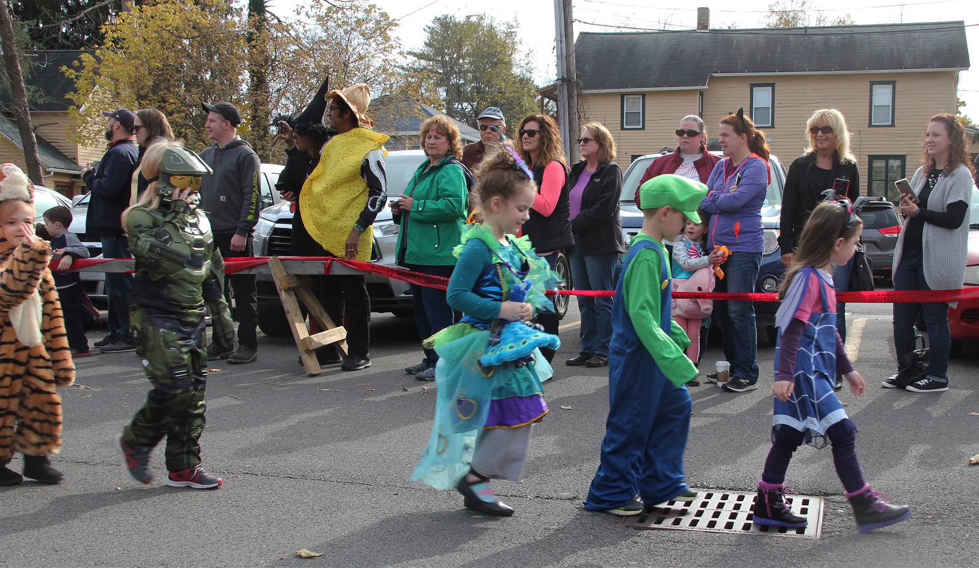 students walking wearing halloween costumes