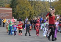 students and teachers parading wearing halloween costumes