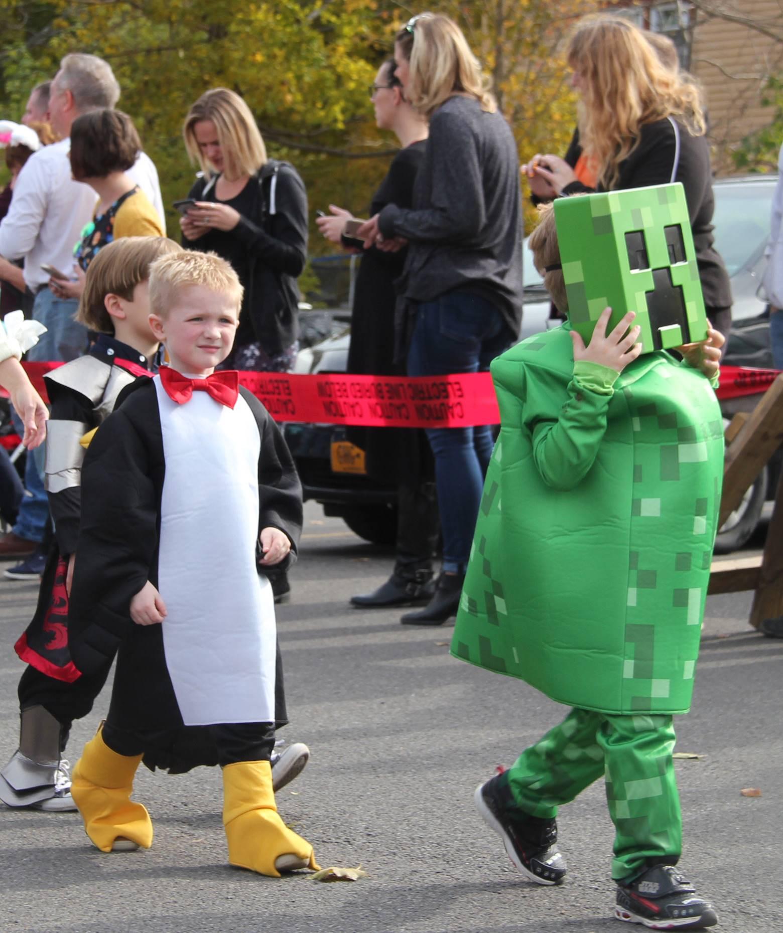 students walking wearing costumes