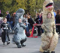students in dinosaur costumes