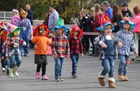 students parading in scare crow hats