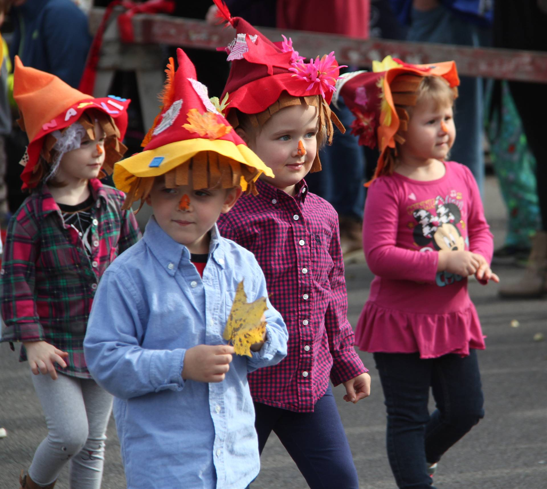 students walking wearing scare crow hats