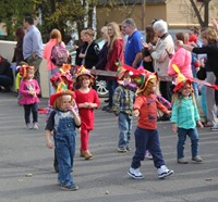 group of students parading wearing scare crow hats
