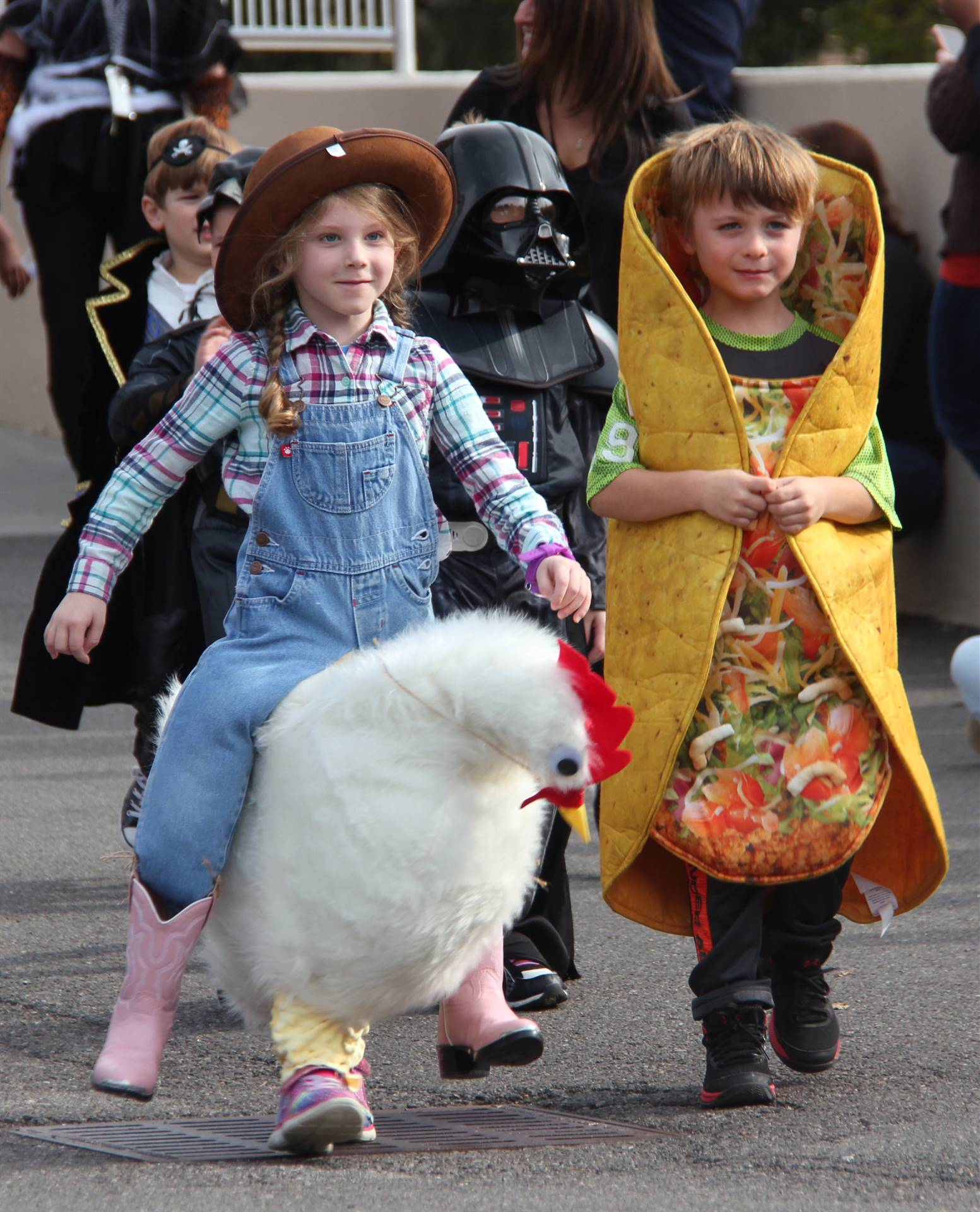 two students wearing halloween costumes