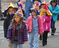 students wearing scare crow hats