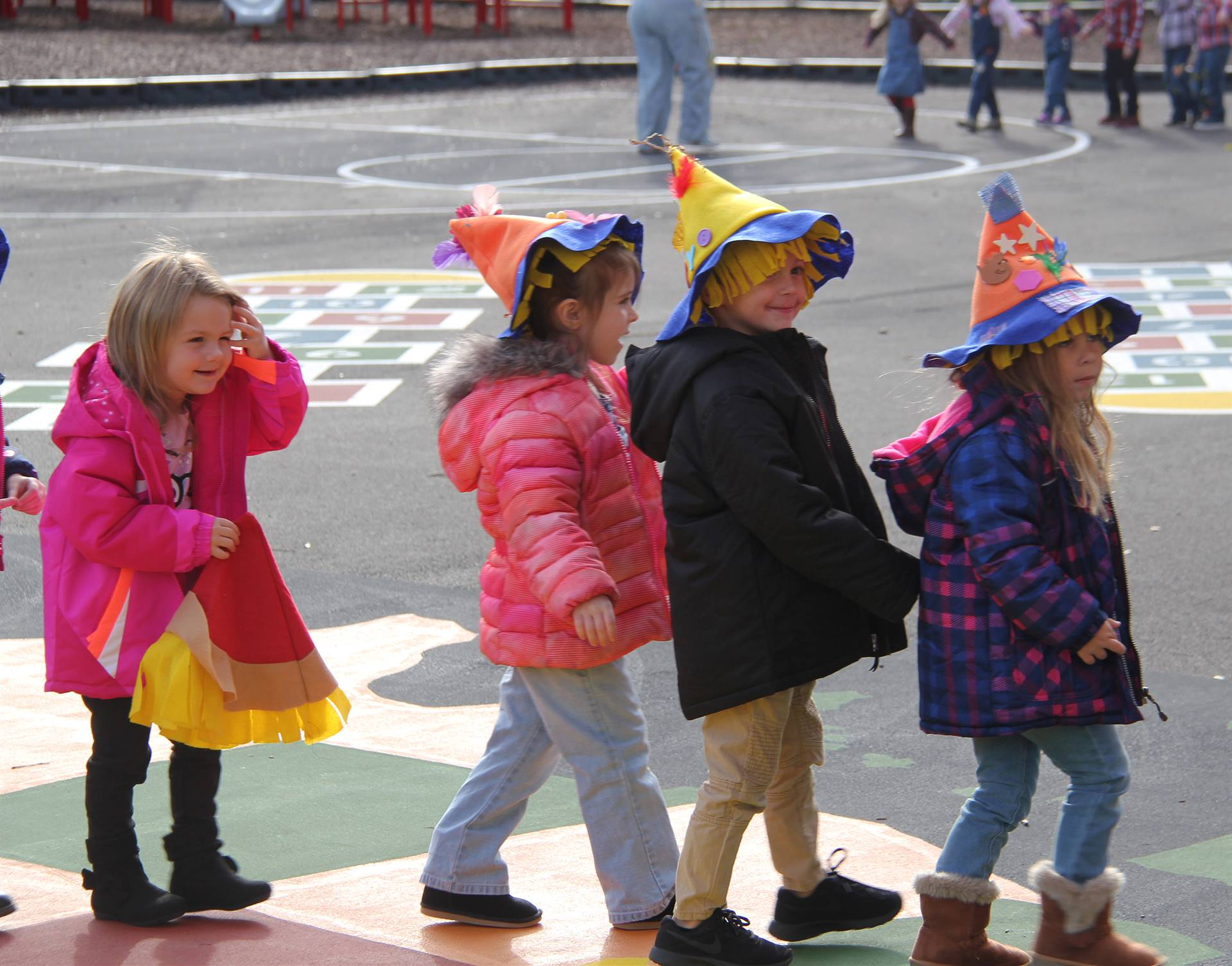 students wearing scare crow hats in parade