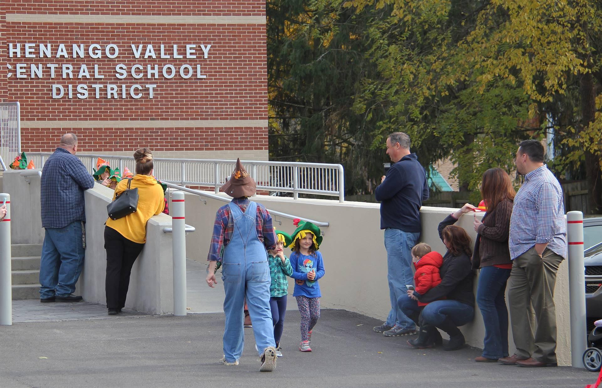 students walking in halloween parade