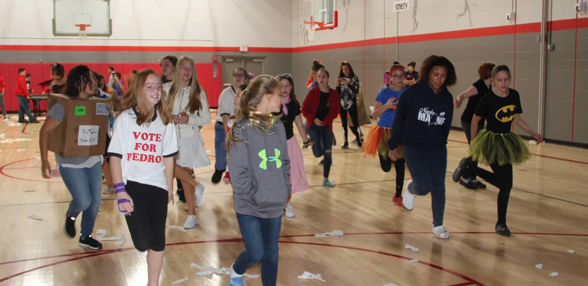 students dancing in gymnasium