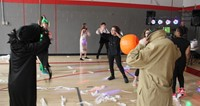 students dancing at halloween event