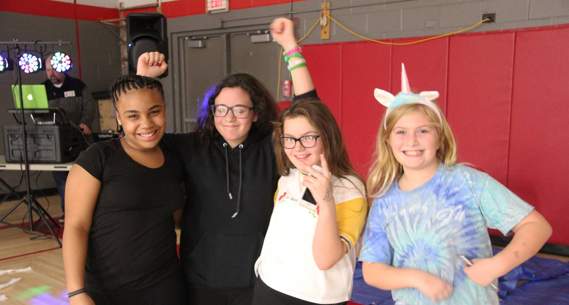 four students smiling at halloween event