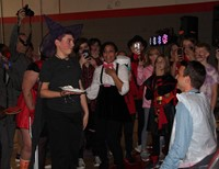 student about to pie teacher in the face for halloween event