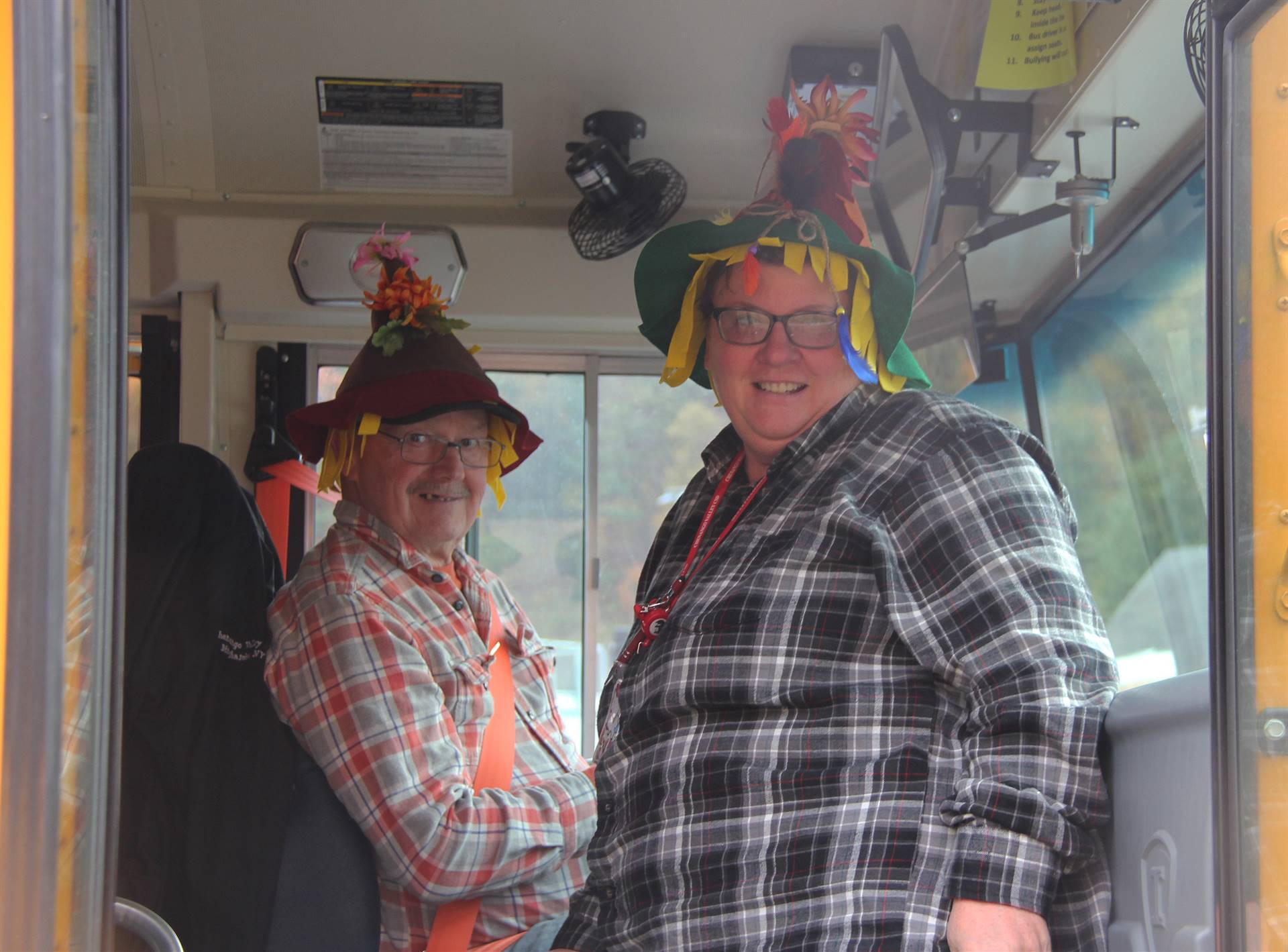 bus drivers wearing scare crow hats