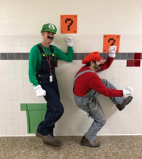 teachers dressed as mario characters pretending to be in game