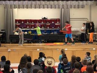students hula hooping on stage