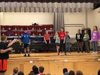students dancing on stage
