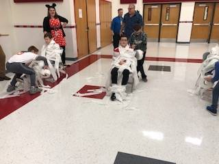 students being mummified with toilet paper