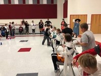 wide shot of students being mummified