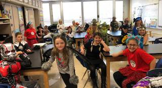 students dressed in costumes in classroom