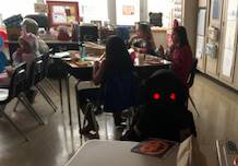 students dressed in halloween costumes in classroom