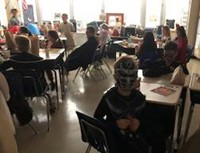students wearing costumes in classroom