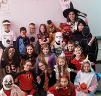class of students in halloween costumes