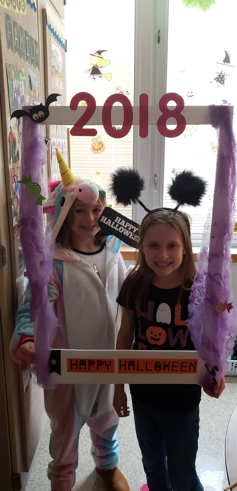 two students in costumes with photo sign