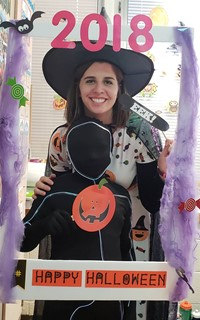 student and teacher wearing costumes at photo booth sign