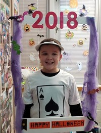 student wearing costume at photo booth sing