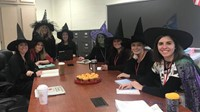group of teachers dressed as witches for halloween