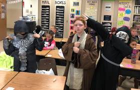 students wearing halloween costumes