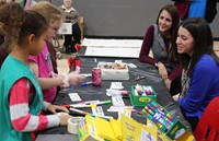 teachers and students at activity table