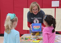 students and teacher at activity station