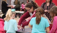 students at girl scouts table