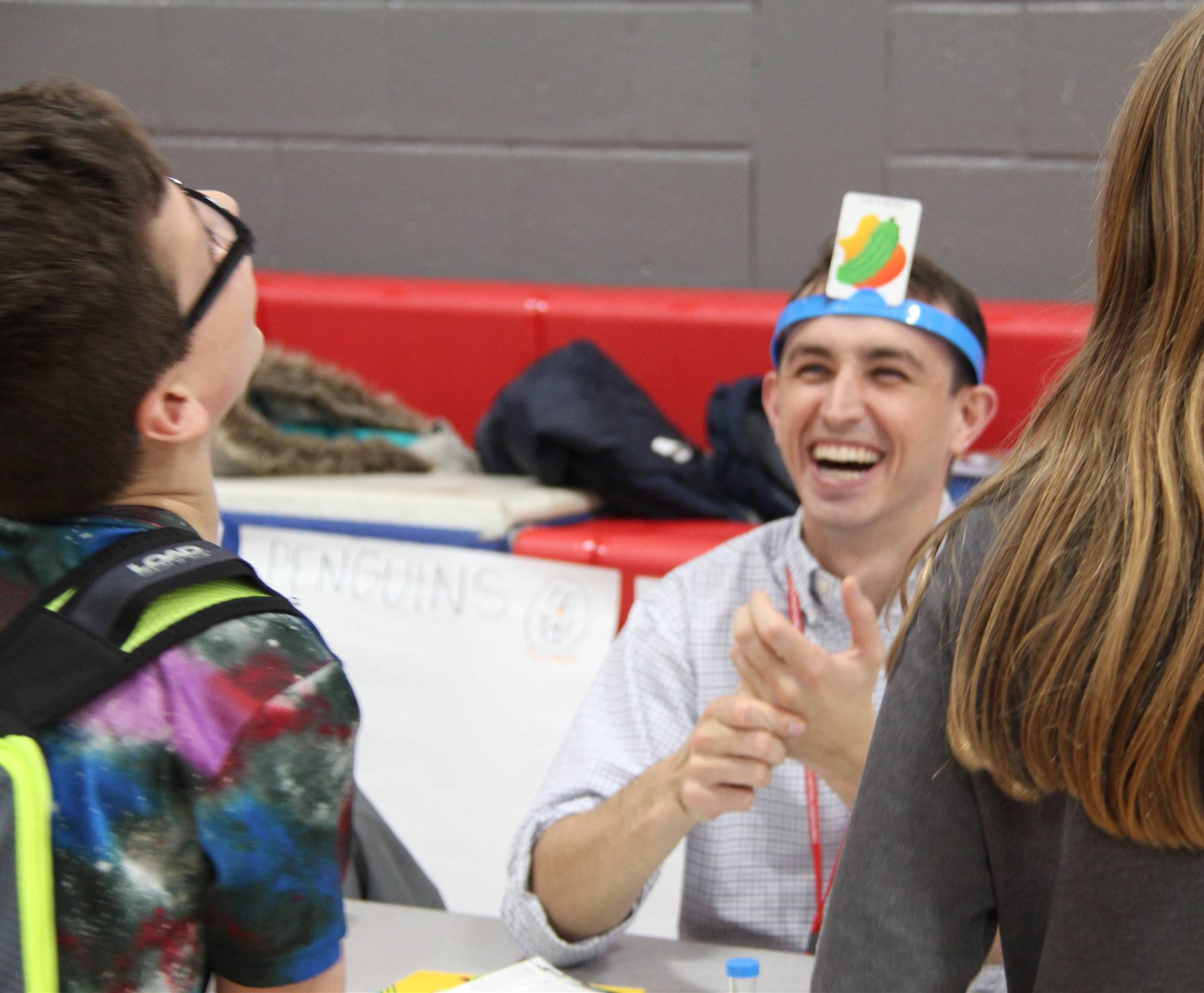 student and teacher laughing during game