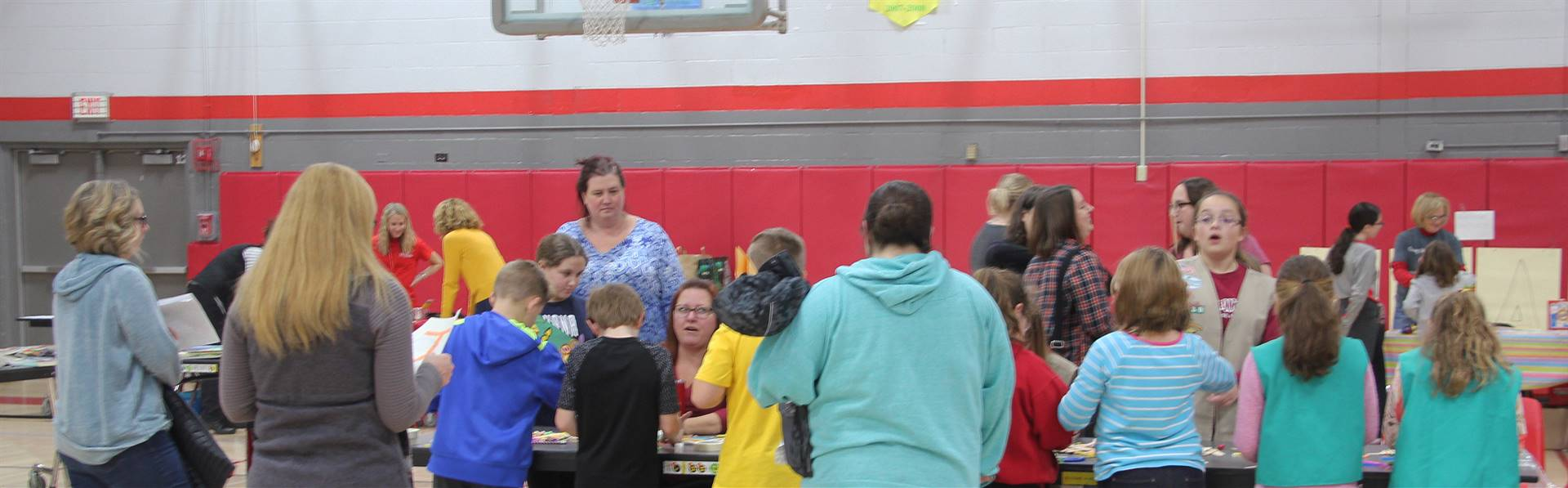 wide shot of people at girl scouts activity table