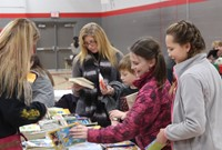 students looking at books